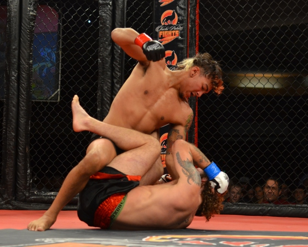 Andre Fili posturing up for a big right hand, as Enoch Wilson defends in guard!
