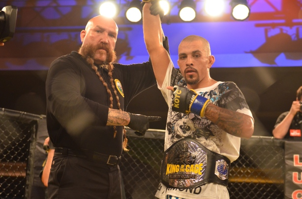 Joshua 'El Rey' Aveles is awarded the victory! with Mike Beltran.